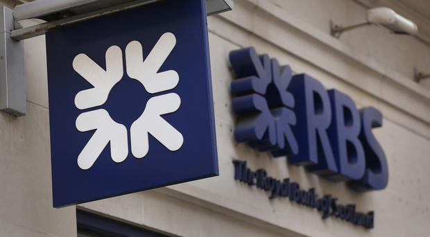 Shares in RBS closed nearly 2% up after a £939 million profit for the six months to June 30