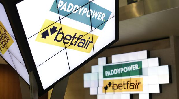 Paddy Power Betfair expects full-year 2017 underlying earnings to be between £445 million and £465 million