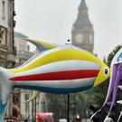 Greenpeace protesters with inflatable sea creatures march from The Mall in London to BP headquarters in St James's Square in a protest about oil drilling