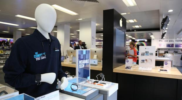 FTSE 100 gains but Dixons Carphone weighs on British mid-caps
