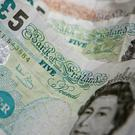 Household budgets pressure is lowering saving and spending, said trade association UK Finance