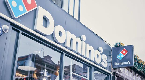 Domino's Pizza, which has 26 branches in Northern Ireland, has shrugged off the trend for consumer belt-tightening to serve up a surge in UK sales