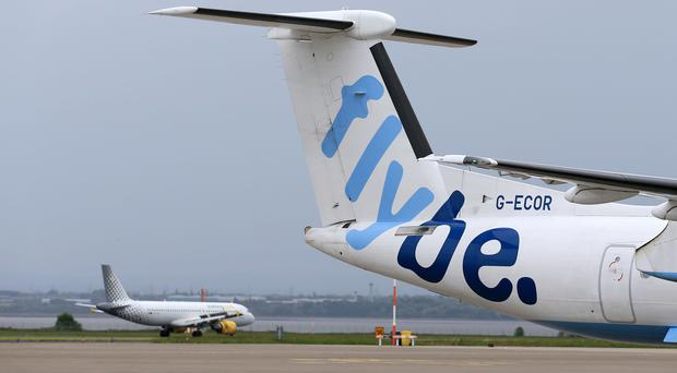 Regional airline Flybe has revealed half-year profits nearly halved after it was hit by higher-than-expected aircraft maintenance and IT costs