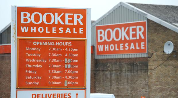 Tesco's £3.7bn takeover bid for Booker provisionally cleared by CMA