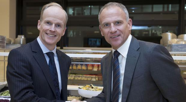 Dave Lewis, CEO of Tesco (right) and Charles Wilson, CEO of Booker after Tesco reached an agreement to merge with food wholesaler Booker in a £3.7 billion deal (PA)
