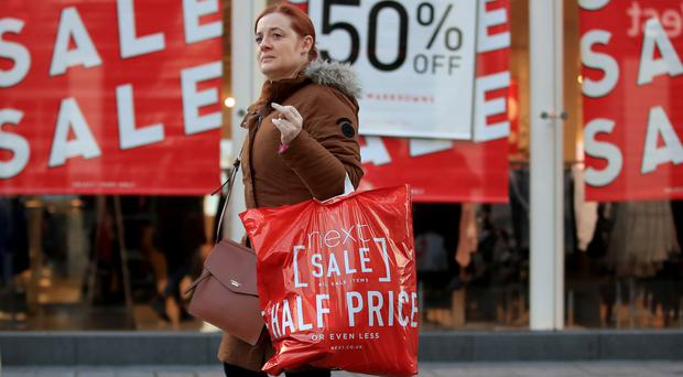 A shopper takes advantage of the Boxing Day sales in Liverpool city centre (Peter Byrne/PA)