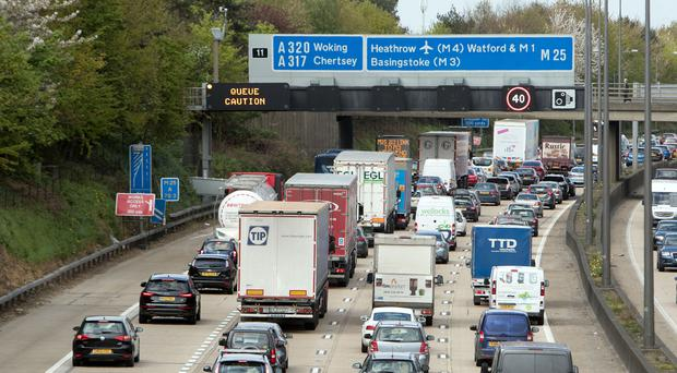 Cars queue on the M25 near Addlestone, Surrey (PA)