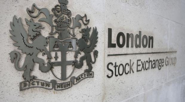 The FTSE 100 closed up 64.89 points to a record 7,687.77 (PA)