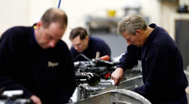 Workers in a factory as the latest manufacturing PMI data is released (PA)