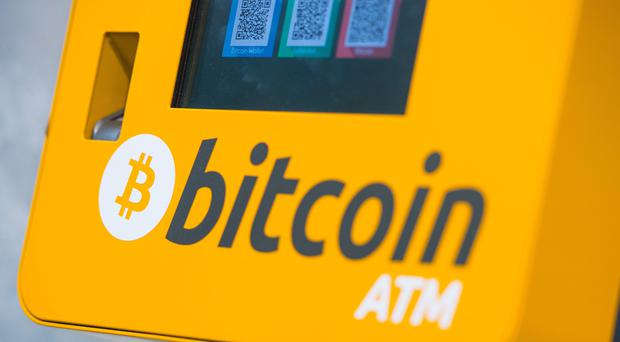 A Bitcoin ATM, as Plus500 enjoyed a boost from cryptocurrency trading (PA)