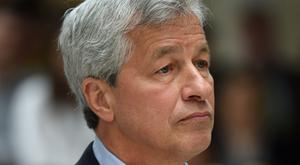 Jamie Dimon said he regrets his criticism of the cryptocurrency (Andrew Matthews/PA)