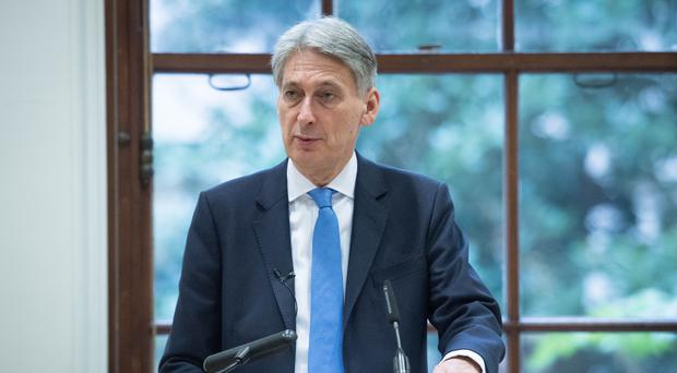 Chancellor of the Exchequer Philip Hammond has been talking about the state of the pound (Stefan Rousseau/PA)