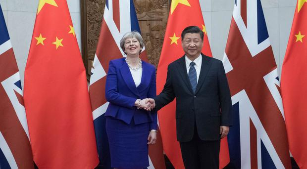 Theresa May shakes hands with Xi Jinping (Stefan Rousseau/PA)