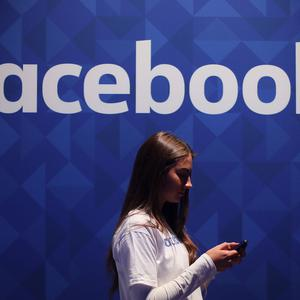 Facebook has pledged to clean up its news feeds (Niall Carson/PA)