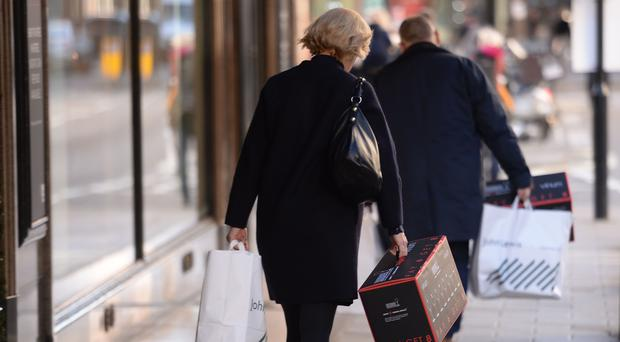 A shopper in Oxford Street, London, as the latest official retail sales figures are released (PA)