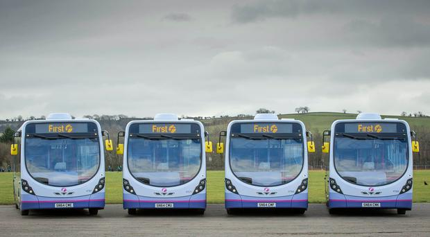 A picture of First Group buses as the company updates on performance (PA)
