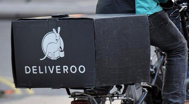Deliveroo cycle rider (PA)