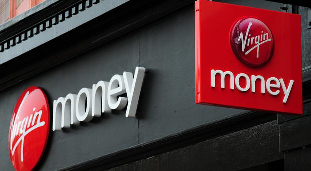 Virgin Money hiked its total dividend 18% to 6p (Rui Vieira/PA)