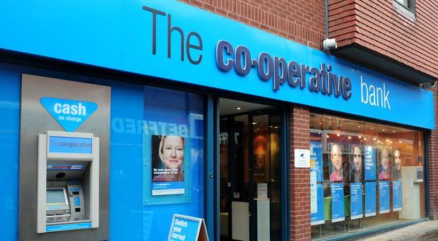 Former Co-operative Bank chair Paul Flowers has been banned from financial services (PA)