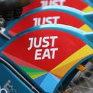 Online takeaway delivery firm Just Eat has swung to a loss in 2017 after taking a mammoth hit on its Australia and New Zealand business, but cheered a record surge in orders