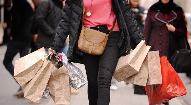 A shopper on the high street following reports that Jigsaw is eyeing fresh investment (PA)