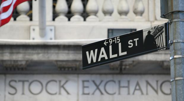 A Wall Street sign outside the New York Stock Exchange (Martin Keene/PA)