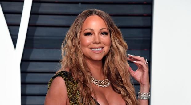 A star-studded advertising campaign featuring celebrities including Charlie Sheen and Mariah Carey is helping boost bookings at online hostel booking site Hostelworld as it posted record annual earnings.
