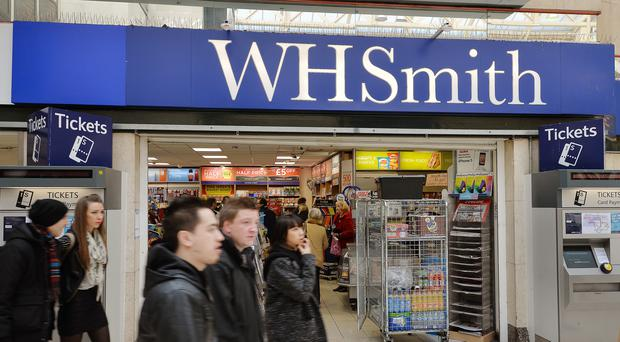 Retailer WH Smith has said it continues to put faith in plans to boost stationery sales to help offset under-pressure high street trading after seeing half-year profits fall.