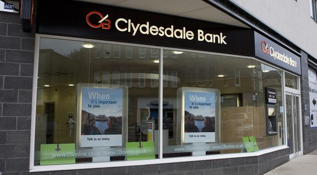 The owner of Clydesdale and Yorkshire banks has slumped into the red with half-year losses of £95 million after taking a hit from the payment protection insurance (PPI) scandal.