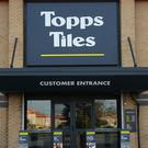 Retailer Topps Tiles has seen half-year profits tumble by more than a third after the Beast from the East and timing of Easter hit sales.