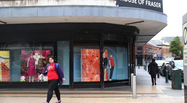Pedestrians pass the Middlesbrough branch of House of Fraser.