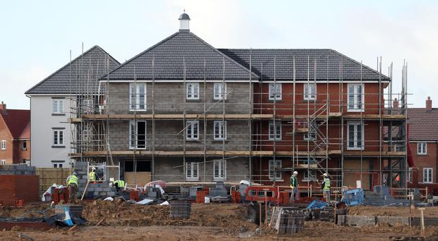 Housebuilders dragged on the FTSE 100 (PA)