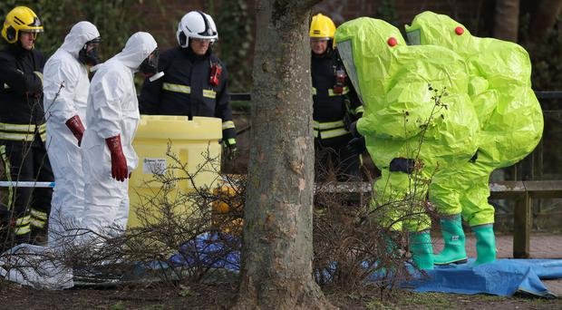 Personnel in hazmat suits in Salisbury, where former Russian double agent Sergei Skripal and his daughter Yulia were found critically ill by exposure to a nerve agent (Andrew Matthews/PA)