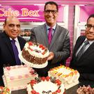 Pardip Dass (right) and Sukh Chamdal (centre) launched the Cake Box franchise in 2009 (Cake Box/PA)