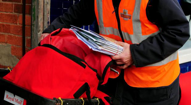Royal Mail has said firms remain uncertain over the recent shake-up of personal data rules as it continued to see a buoyant parcels business offset by falling letter deliveries (Rui Vieira/PA)