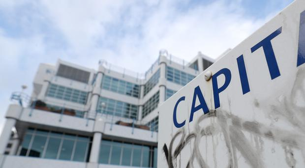 Capita's shares have slumped after the company posted plunging profits and axed a handout to investors (Andrew Matthews/PA)