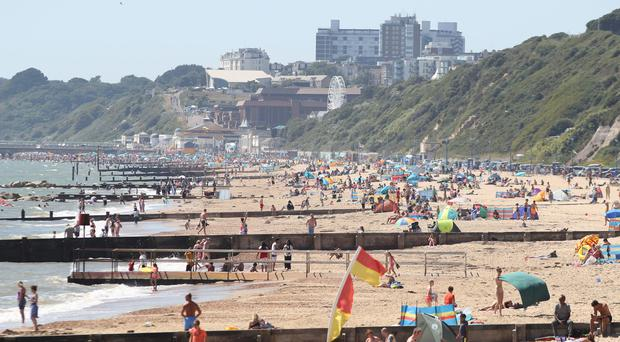 The recent heatwave is expected to have boosted the economy (PA)