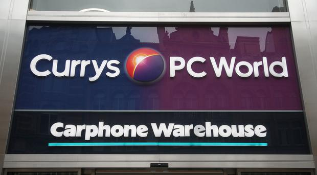 Dixons Carphone said profits are on track (PA)