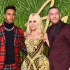 Donatella Versace with Lewis Hamilton and Conor McGregor (Matt Crossick/PA)