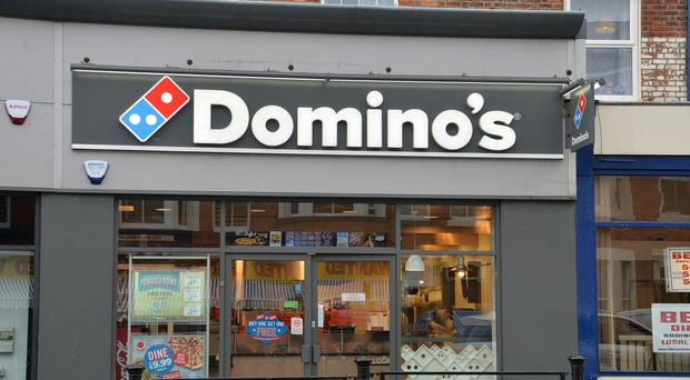 "Domino's Pizza has seen UK sales growth more than halve after ""evident uncertainty"" among customers and unusually hot weather took its toll (Anna Gowthorpe/PA)"