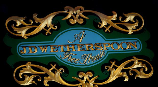 JD Wetherspoon logo outside The Lord Burton pub in Burton on Trent, Staffordshire.