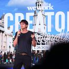 "Ashton Kutcher presents the WeWork London Creator Awards at Printworks, London. The flexible working company says it is still ""committed"" to London (PA)"