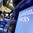 FILE – In this Dec. 13, 2016, file photo, the logo for Goldman Sachs appears above a trading post on the floor of the New York Stock Exchange. (AP Photo/Richard Drew, File)
