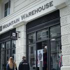 Shoppers pass a Mountain Warehouse store in central London (PA)