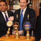 Happier times: Former chancellor George Osborne pulls a pint of Sunbeam ale alongside chief executive Ralph Findlay (PA)