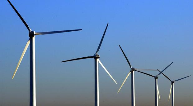 Energy firm SSE is to sell a stake in its Stonelairg and Dunmaglass wind farms for £635m (Phil Noble/PA)
