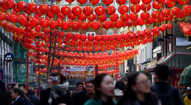 Lanterns are strung across Gerrard Street in Chinatown, London. Shaftesbury owns several properties in the area (PA)