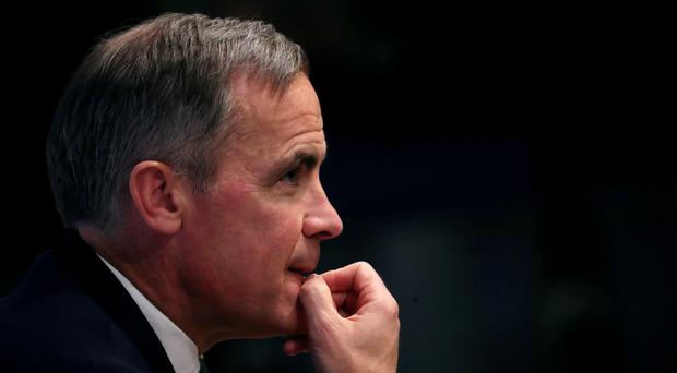 Pound traders were reassured by upbeat comments from Carney, despite a reduction in growth expectations (PA)