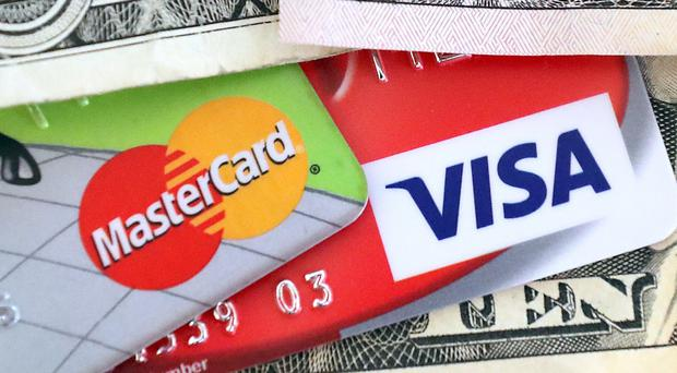 Two credit card titans are going toe to toe (PA)