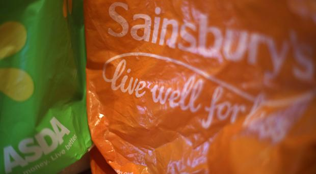 The investigation into the merger of two of Britain's biggest supermarkets has been extended (PA)